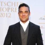 """Robbie Williams: il biopic diretto dal regista di """"The Greatest Showman"""" Michael Gracey"""